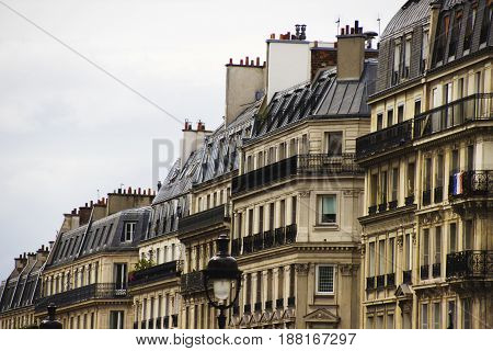 Traditional French Architecture. House in Paris. Parisian building. Typical generic houses in Paris France. Photo stock.