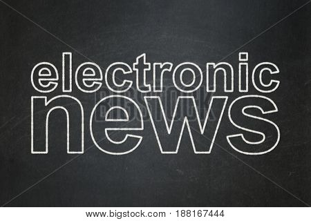 News concept: text Electronic News on Black chalkboard background