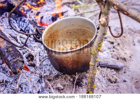 For cooking in nature they use such metal bowlers to cling them to a stick and place them over fire