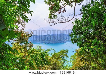 View of Sun Moon Lake through forest trees