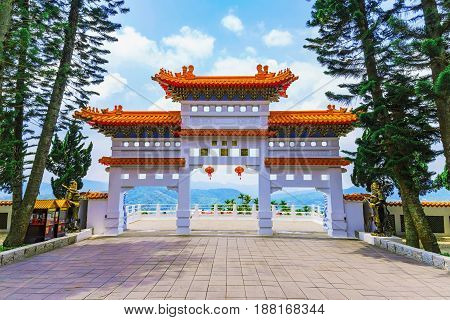 Traditional architecture of a temple entrance with nature