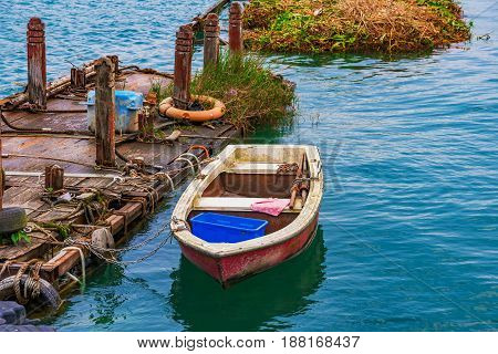 Boat and wooden raft on Sun Moon Lake