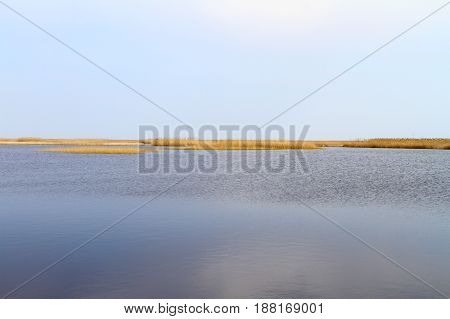 Lake under nice sky scene on lake in steppe landscape