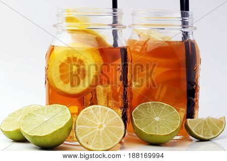 Iced Tea With Lemon Slices And Mint On White Background