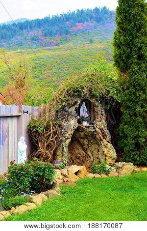 Spiritual prayer garden with a Virgin Mary sculpture taken at a monastery in the mountains