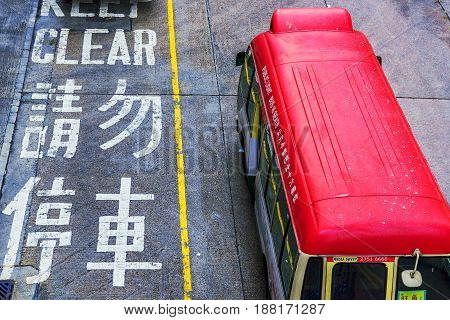 HONG KONG CHINA - APRIL 27: This is an aerial view of a local bus driving down a road in the Mong Kok area of Hong Kong on April 27 2017 in Hong Kong