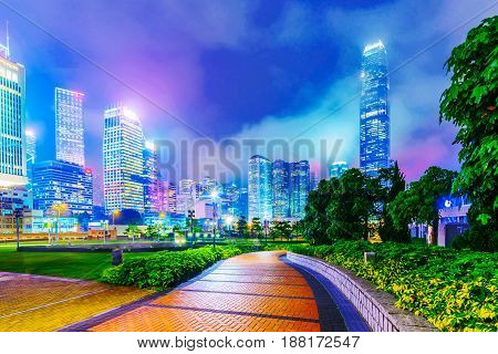 HONG KONG CHINA - APRIL 25: View of skyscrapers and architecture from Tamar park in the financial district of Hong Kong at night on April 25 2017 in Hong Kong