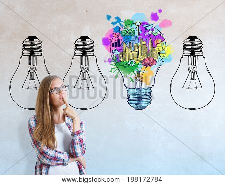 Portrait of young european woman on concrete background with business sketch and lamps. Idea concept