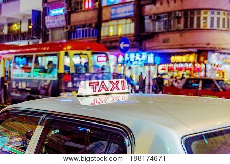 HONG KONG CHINA - APRIL 24: This is a typical Hong Kong taxi in the busy Mong Kok area at night on April 24 2017 in Hong Kong