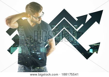 Thoughtful young businessman on city background with upward chart arrows. Financial growth concept. Double exposure