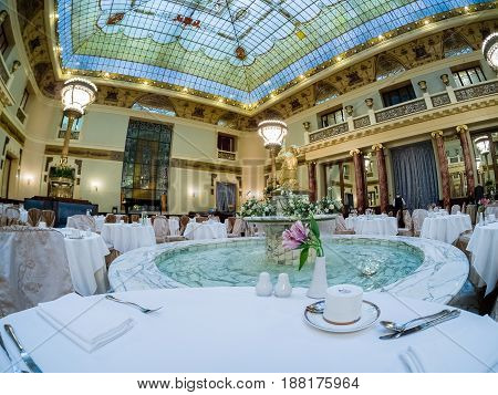 MOSCOW RUSSIA - APRIL 27 2017: Marble fountain of Metropol hotel main restaurant in Moscow Russia on April 27 2017. Hotel was built in 1899-1907 in Art Nouveau style.