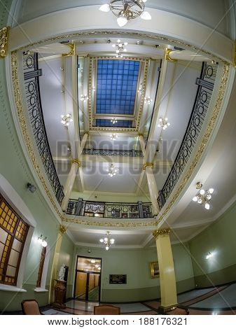 MOSCOW RUSSIA - APRIL 27 2017: Multistory interior atrium in Metropol hotel in Moscow Russia on April 27 2017. Hotel was built in 1899-1907 in Art Nouveau style.