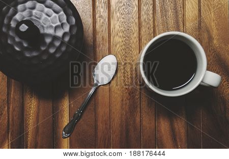 Hot Cup Of Coffee And Spoon Full Of Sugar