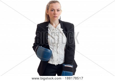 sexy young girl in shirt and jacket with boxing at the hands of prechatkami stands up straight and looking at camera isolated on white background