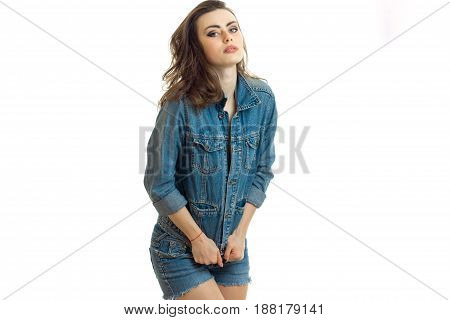 young sexy girl worth bending head in a jeans suit close-up isolated on white background