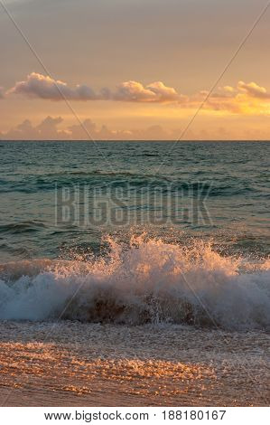Stormy ocean on sunset background. Tropical beach