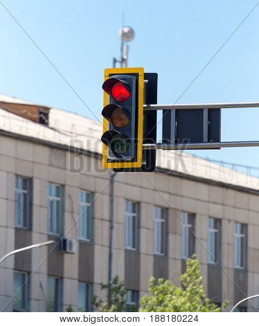 Traffic light on the road in the city .