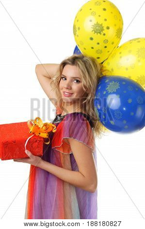 young woman in colourful dress holding bunch of yellow and blue balloons and present studio isolated on white background