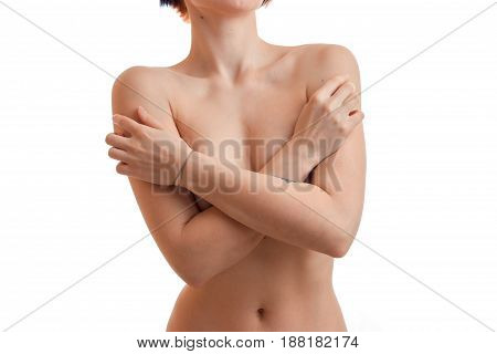 young girl closes two hands his naked chest close-up isolated on white background