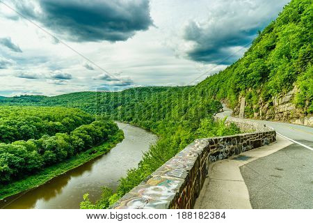 Upper Delaware river bends through a green forest, New York and Pennsylvania