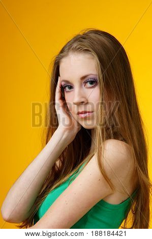 young beautidul female with healthy skin lookining at you