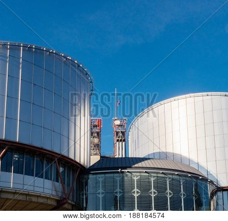 STRASBOURG FRANCE - MAY 26 2017: European Union flag fly half-mast European Court of human Rights building memory of victims terrorist explosion Manchester Arena Ariana Grande concert