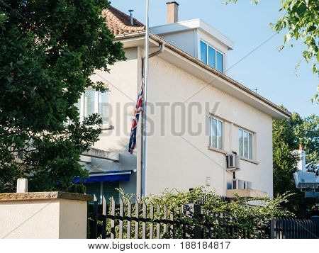 STRASBOURG FRANCE - MAY 26 2017: United Kingdom flags fly half-mast British Consulate building memory of victims terrorist explosion Manchester Arena