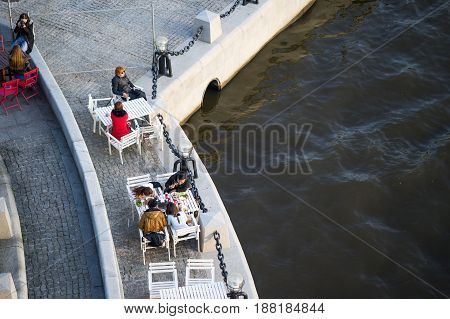 Moscow, Russia, 18 may 2017: people sit in cafes on the waterfront near Moscow river. view from the top