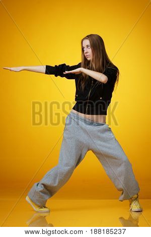 young woman dancing hip-hop and not looking in camera