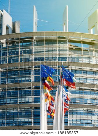 STRASBOURG, FRANCE - MAY 26, 2017:  Front view of European Union flag fly half-mast European Parliament building memory of victims terrorist explosion Manchester Arena