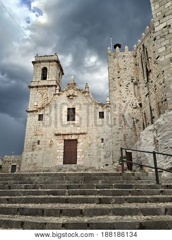 Medieval castle under dramatic sky. Castell de Peniscola in the province of Castellon Valencian Community Spain.