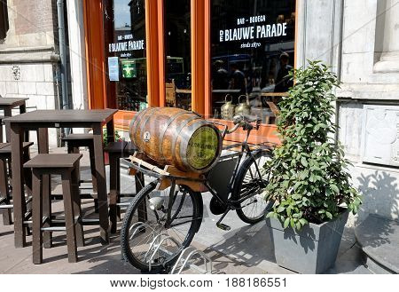 AMSTERDAM NETHERLANDS - MAY 14 2017: Advertising bicycle with a barrel of beer on the trunk