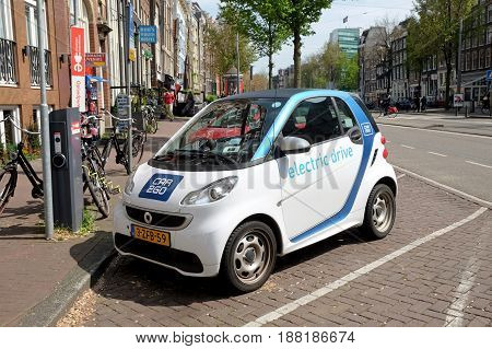 AMSTERDAM NETHERLANDS - MAY 14 2017: Electric car is charging at a point in the street