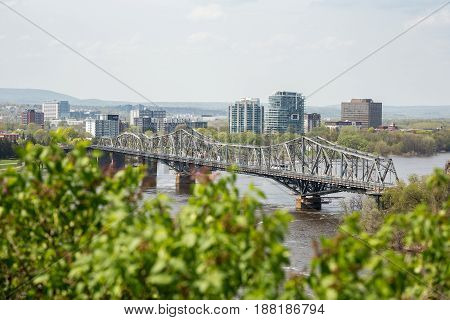 View of the Royal Alexandra Interprovincial Bridge spanning the Ottawa River between Ottawa, Ontario and Gatineau, Quebec. It is known locally as both the Alexandra  and the Interprovincial Bridge.