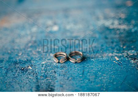 Wedding rings on a textured background. Wedding in Montenegro