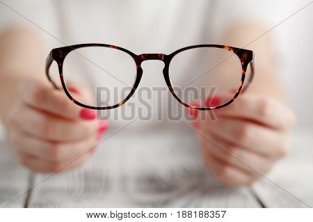Woman Hand holding glasses on white background