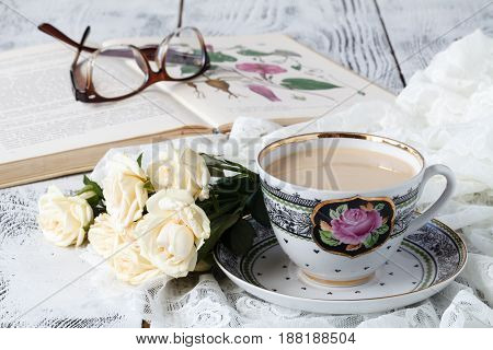 Cup Of Tea And White Flower Near It. Morning Coffee