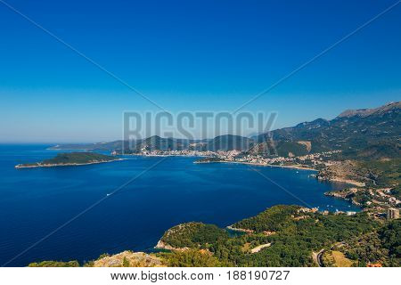 Panorama of the coastline of Budva Riviera from the mountain on a sunny day. Montenegro.