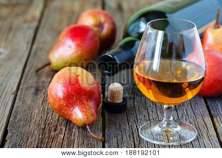 Traditional Chilean pear brandy on rustic table