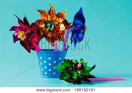 Kid toys on plain pastel aquamarine background