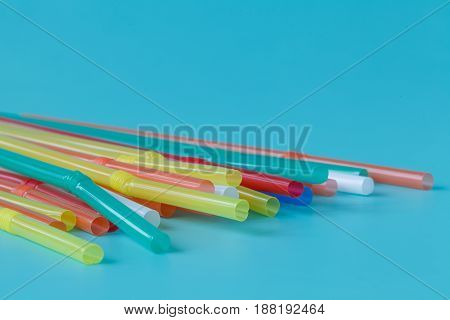 colored tubules for juice and cocktails on plain background