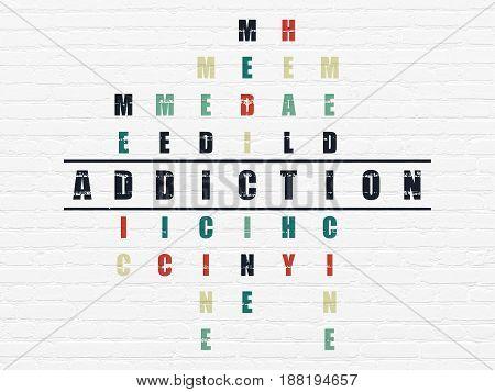 Medicine concept: Painted black word Addiction in solving Crossword Puzzle