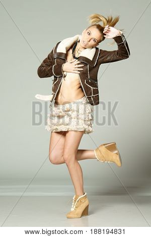 studio fashion style photo of young sexy woman posing dynamic
