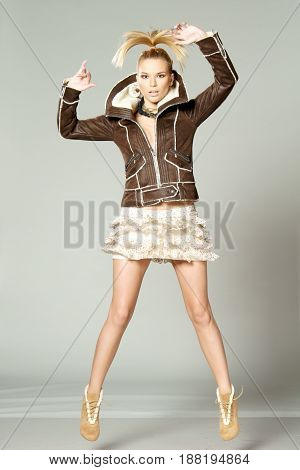 studio fashion style photo of young sexy woman posing dynamic or juming