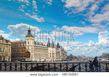 View of La Conciergerie, ex royal palace and prison, and Seine river in Paris, France in winter day.