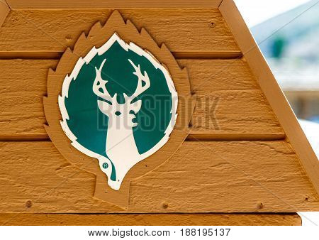 Park City UT May 12 2017: Deer Valley ski resort logo is depicted on a side of a trash receptacle at the base of the ski resort.