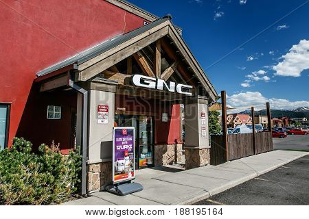 Park City UT May 12 2017: Entrance to a GNC store at Kimball Junction.