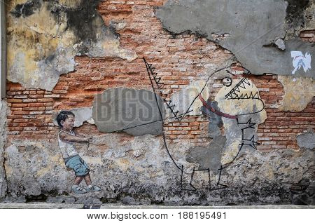 Street Art Titled Little Boy With Pet Dinosaur By Ernest Zacharevic