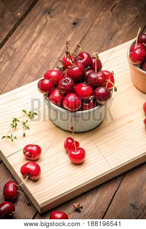 Red Ripe Cherries In Ceramic Bowls