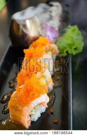Salmon Sushi Served On Black Plate stock poto
